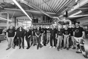 Gruppenbild Team copado. in der Werkstatt